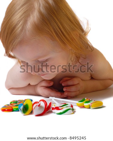 baby with candy - stock photo