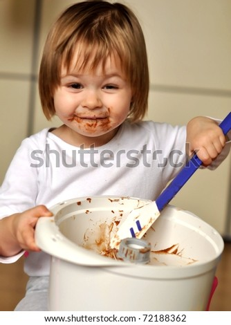 baby with chocolate - stock photo