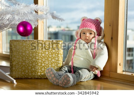 Baby with Christmas background and gift - stock photo