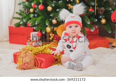 baby with costume snowman with Christmas tree