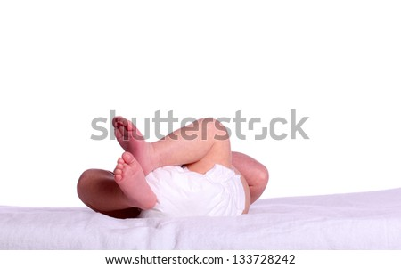 baby with diaper sleeping on white - stock photo