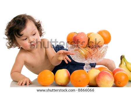 Baby with fruits,isolated on a white background.
