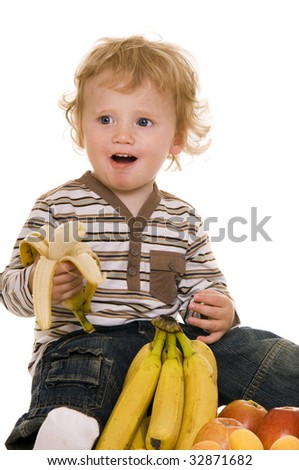 Baby with fruits isolated on white. - stock photo