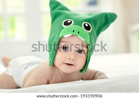 Baby with funny cap on head - stock photo