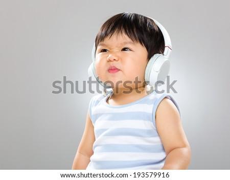 Baby with headphone - stock photo