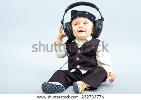 baby with headphone, boy - stock photo