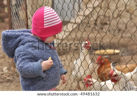 baby with hen