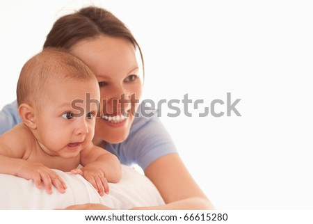 baby with her mother on the white - stock photo
