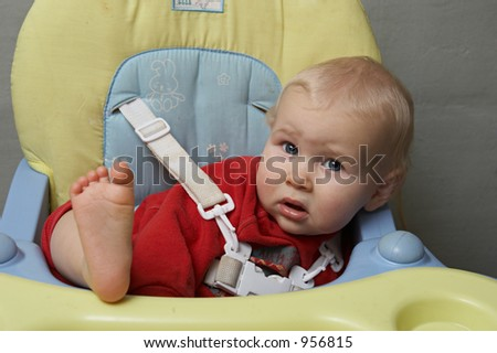 baby with his foot on the table - stock photo