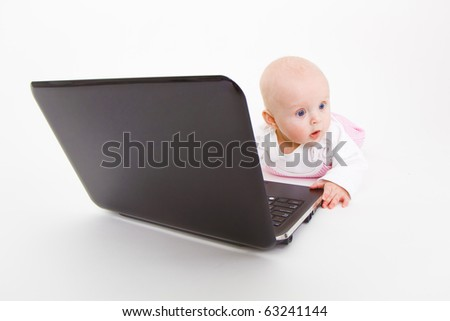 baby with laptop on a white background in studio