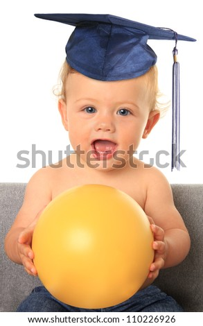 Baby with mortar board. Add your own text on the yellow ball. - stock photo