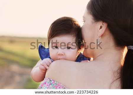 baby with mother outdoor