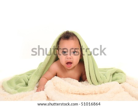 Baby With Mouth Open Lying on Tummy With Blankets - stock photo