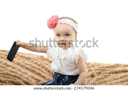 baby with phone - stock photo