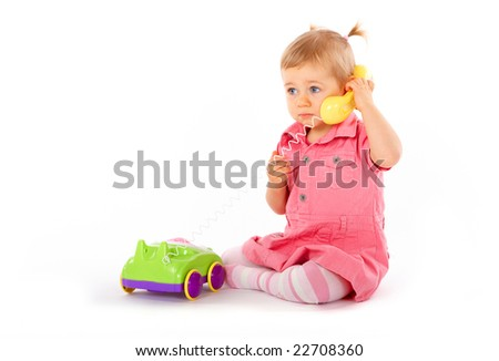 Baby with phone, isolated on a white background.