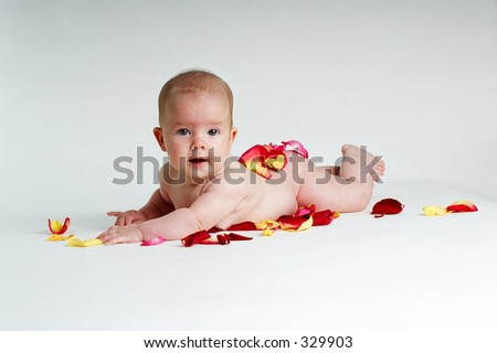 Baby with rose petals