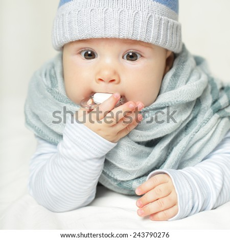 Baby with soother - stock photo