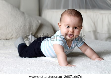 baby with tongue - stock photo