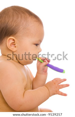 Baby with toothbrush