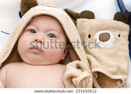 baby wrapped in a towel brown - stock photo