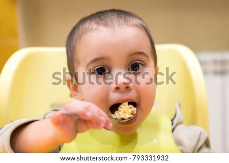 baby 1 year eating a spoon