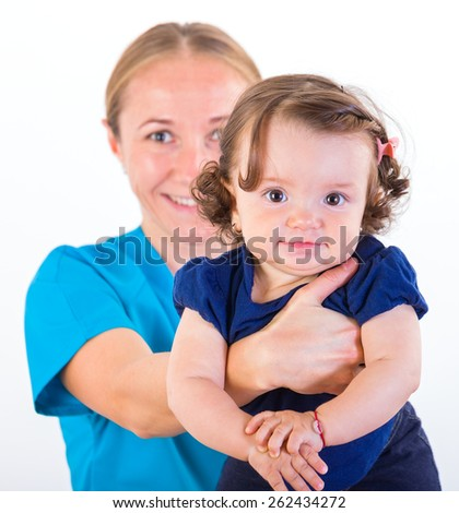 Babysitter holding in arms an adorable baby girl  - stock photo