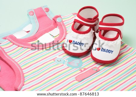 Babywear on Green Background - stock photo