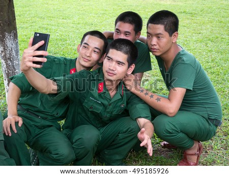 BAC GIANG, VIET NAM, July 14, 2016 the group soldiers, army Vietnam, souvenir photograph, resting, place the school sports