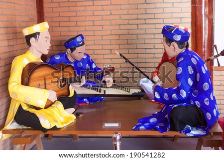 "BAC LIEU, VIETNAM - MAR, 03: Model of Vietnamese artists playing traditional music called ""cai luong"" in museum. On march 03, 2012."