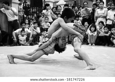 BAC NINH, VIETNAM - MAR 24, 2010: An unidentified kid-stage of wrestle competition to celebrate the lunar new year of Vietnam at Nguyen village in Tu Son town.