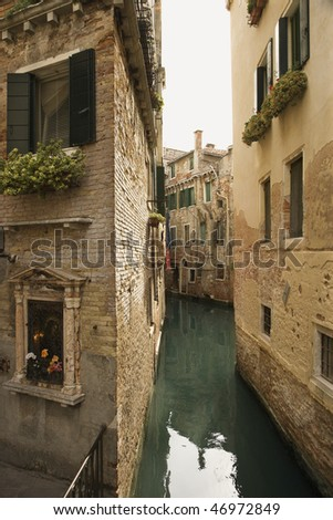 Back alley waterway in Venice, Italy. Vertical shot. - stock photo