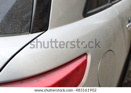 Back close up view of the gray car and light in parking.