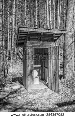 Back Country Outhouse #3 - (B&W Filter Applied) - stock photo