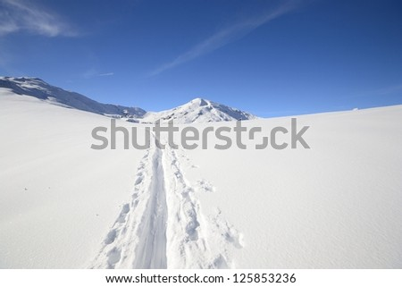 Back country skiing in scenic high mountain landscape and superb view. - stock photo