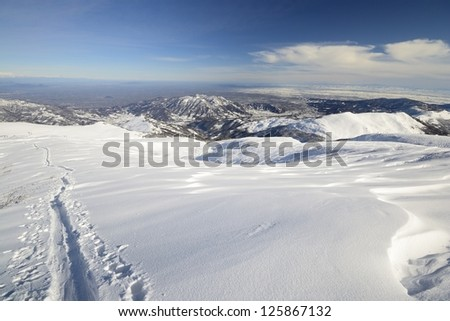 Back country skiing in scenic high mountain landscape and superb view - stock photo