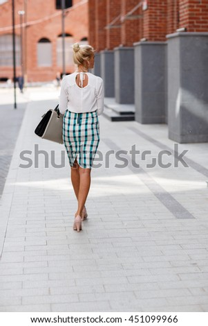 back girl in shoes on heels - stock photo