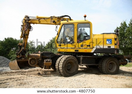 Back-hoe - at present equipped for repair of railroad tracks. - stock photo
