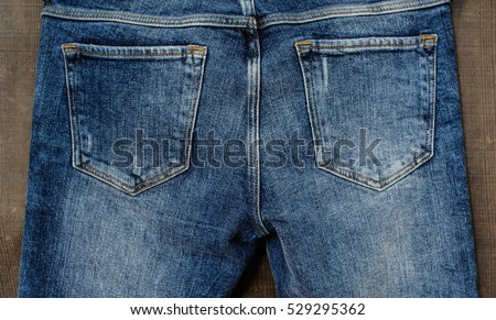 Back jeans pocket-wooden background