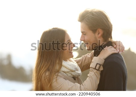 Back light of a couple looking each other isolated in white above - stock photo