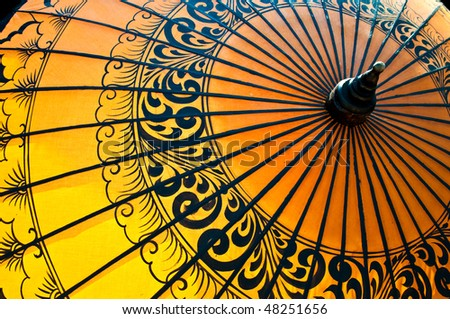 Back-lit traditional Burmese umbrella - stock photo