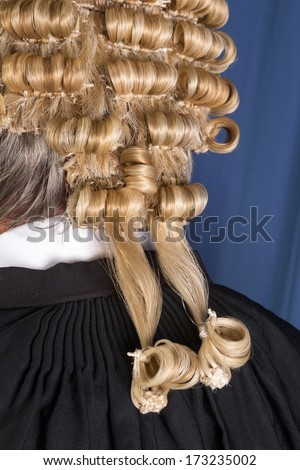Back look of a lawyer wearing an authentic horsehair wig - stock photo