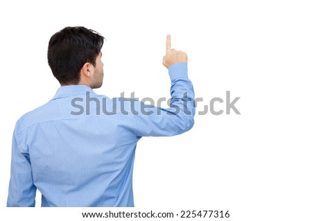 Back of a business man pointing at something with his finger - stock photo