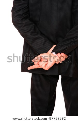 back of a businessman showing a finger behind his back   isolated on white background