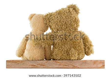 Back of a couple of cute brown bears sitting on wood with big one hugging little girl isolated on white background