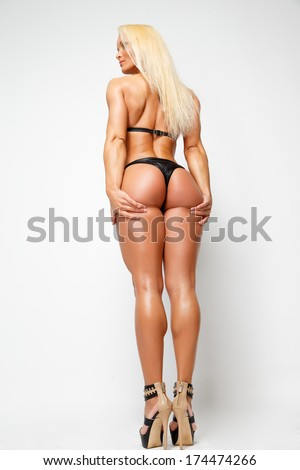 Back of a muscled blonde model - stock photo