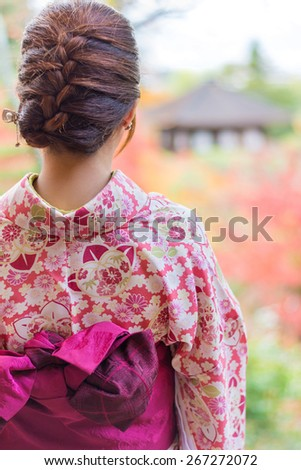 Back of a pretty Japanese girl in beautiful atmosphere. This picture has soft focus. - stock photo
