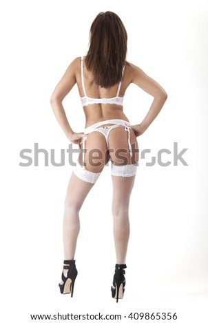 back of a woman in white underwear  - stock photo