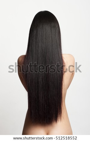 Back of a young nude woman with beautiful black hair