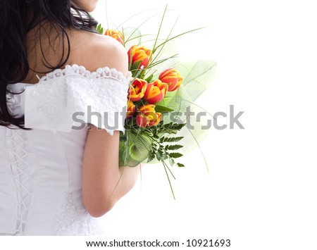 Back of beautiful bride with bunch of tulips. With copy space - stock photo
