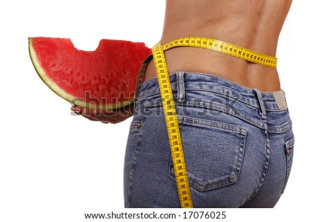 Back of beautiful woman holding a watermelon slice - health and beauty. - stock photo